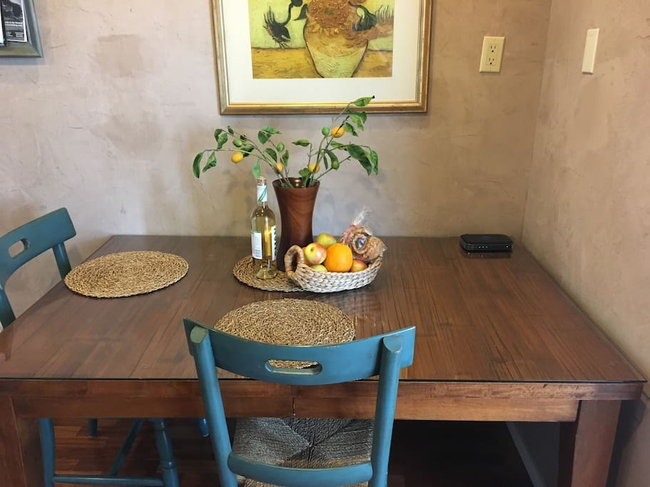 "Dining table and work space and a ""Welcome to Los Osos"" basket of goodies."