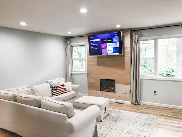 Upstairs Living room, giant sectional, smart Tv, dimmable lights, electric fireplace