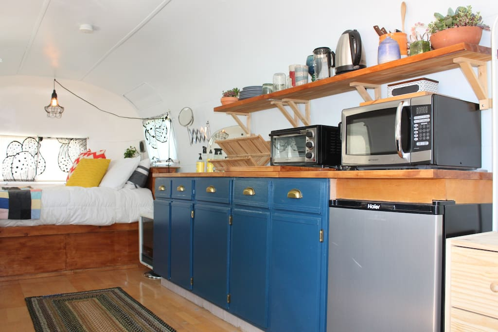 kitchen with microwave, coffee station, toaster oven, fridge, sink, etc
