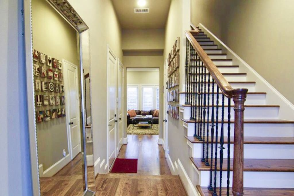 Exquisite Inviting entry into the modern townhouse with first floor living area and all natural hard wood flooring!