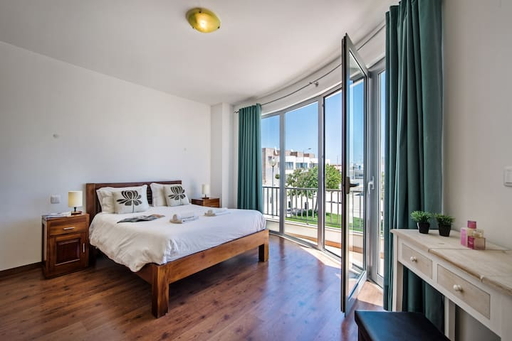 The master bedroom with floor to ceiling windows to make the best of the view