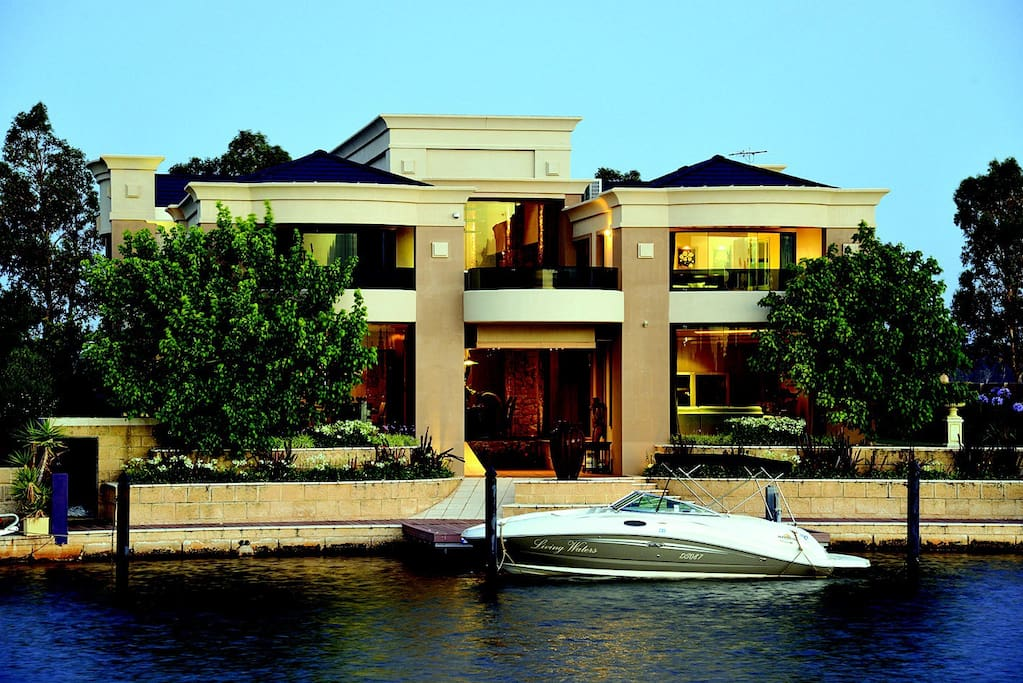 Canalview of this beautiful home with it's magnificent curved windows and balconies