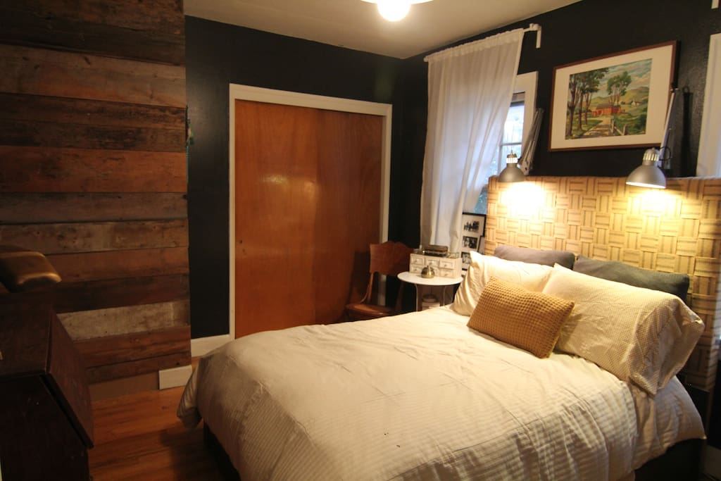 Bedroom with double bed and the coolest headboard you've ever seen.