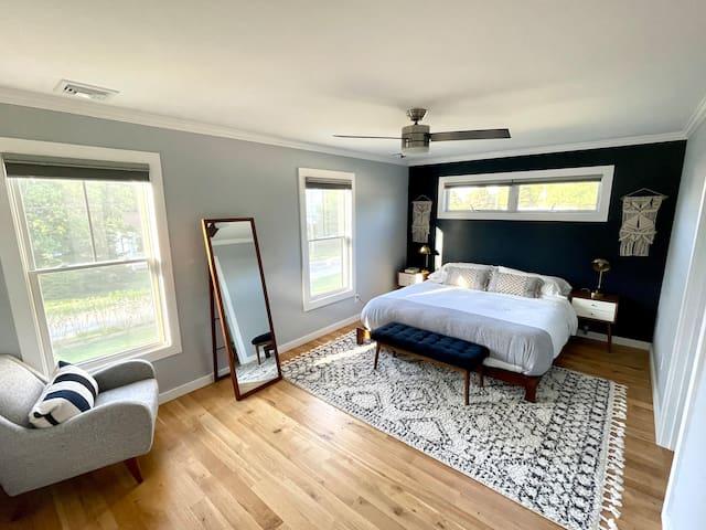 "Primary bedroom with king bed, walk-in closet, en-suite and 55"" TV."