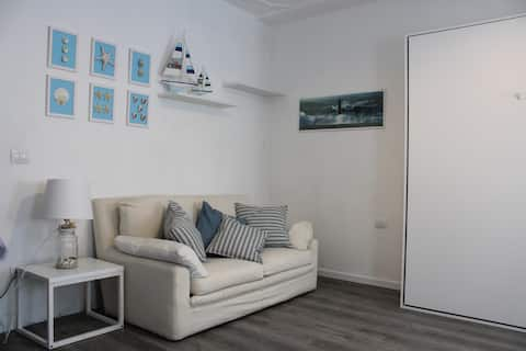 Second-floor apartment in Chioggia's main square