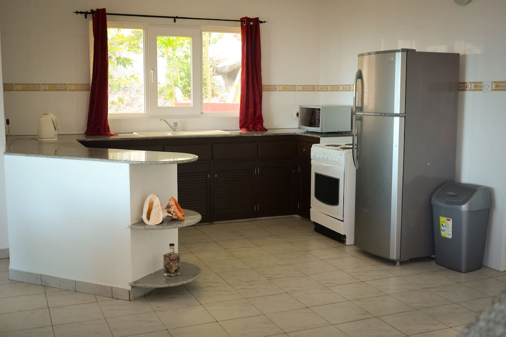 Fully-functional kitchen equipped with even a toaster, kettle and microwave.