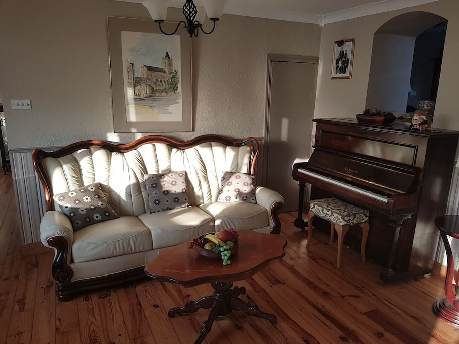 Sitting Room - Seating area with piano