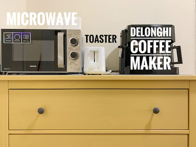 Delonghi coffee maker, microwave, toaster