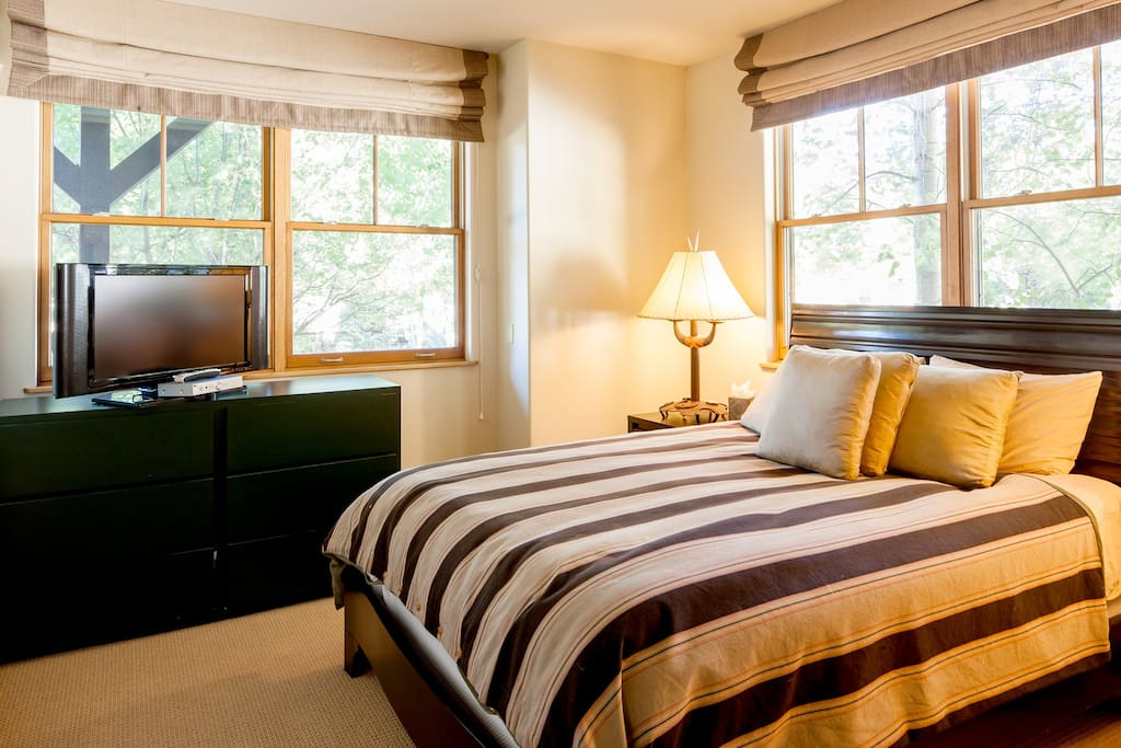 One of the 4 bedrooms, equipped with a full sized bed, soft sheets and beautiful views.