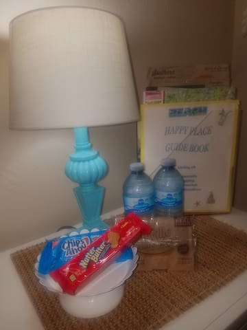 Now that you have arrived, you can relax with some night time snacks! Who doesn't like popcorn and cookies? Then there's a nice fresh bottle of water for your enjoyment! Kick your feet up, watch a movie while enjoying some snacks!!!
