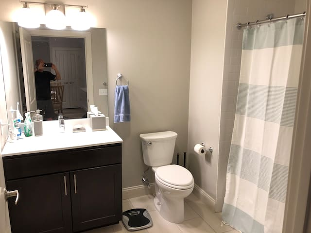 Bathroom with full bath and shower