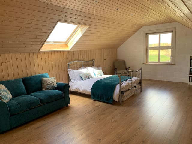 Spacious Double bedroom with a further sofa bed for extra guests.