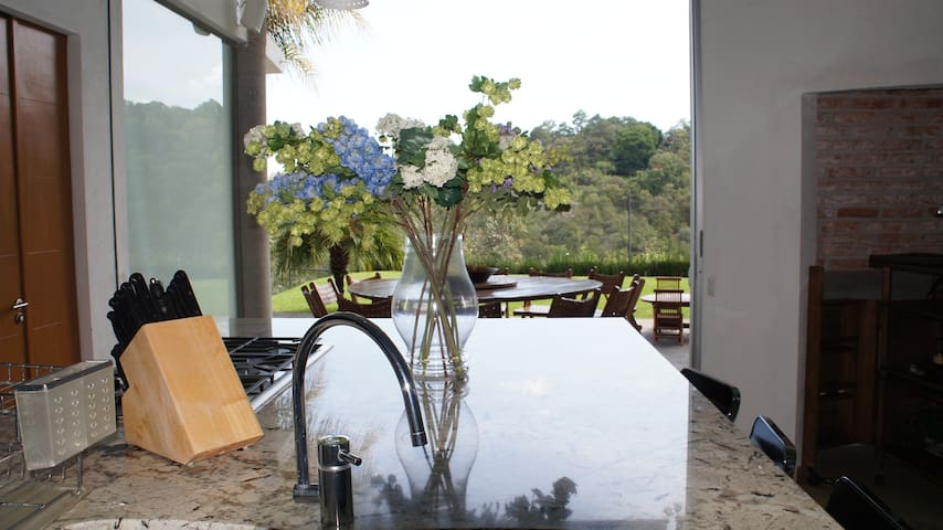 Kitchen and dining terrace are integrated in the same area