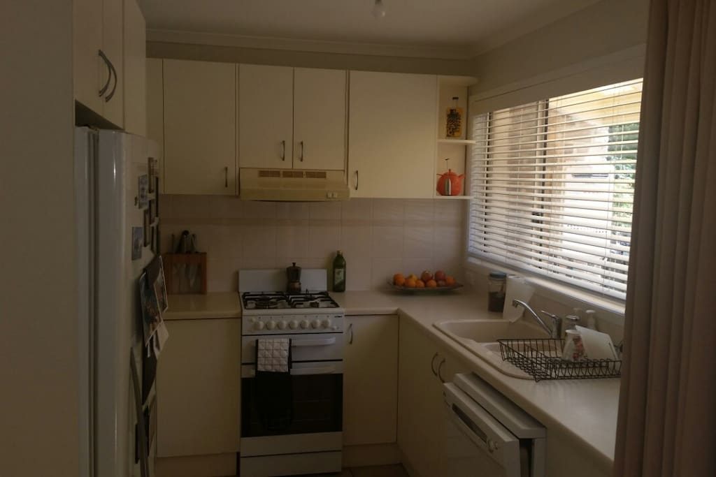 Kitchen includes a gas oven, dishwasher and large fridge