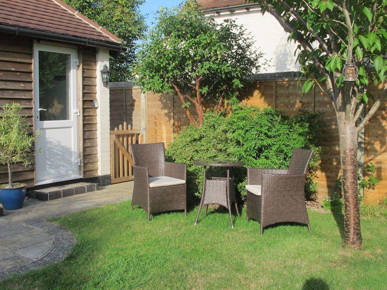 Door opens onto garden seating