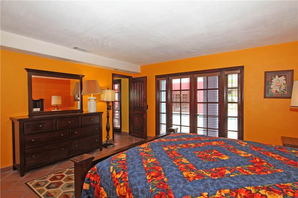 Master bedroom is just off family room.  Master bedroom with french doors opening to patio