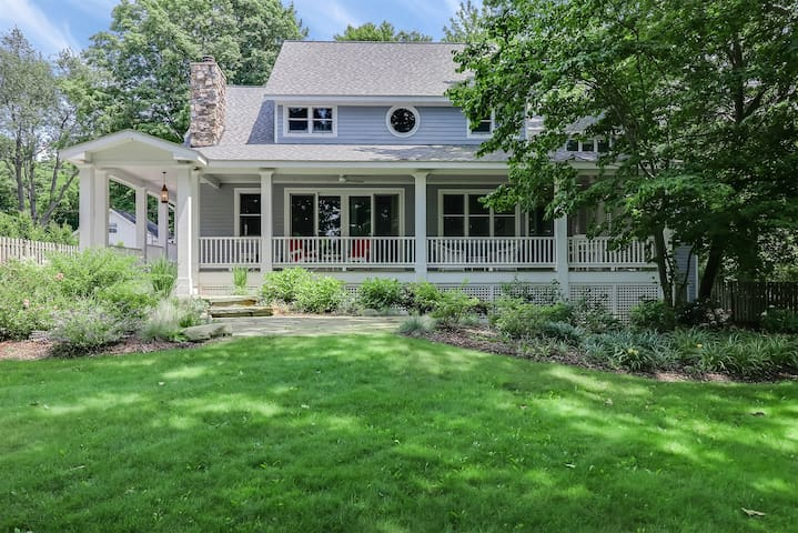 True Companion: Beautiful Lake Michigan Home with Private Frontage, Sprawling Lawn, and Covered Front Porch