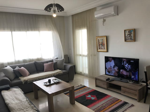 Sunny apartment in bustling central neighborhood