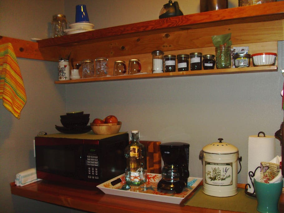 Mini fridge with water, microwave, coffee pot with assorted coffee, tea and fresh fruit