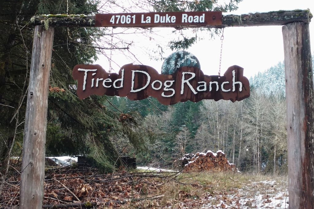 Signage at entry of Tired Dog Ranch located approximately 4 miles west of Oakridge/Westfir.