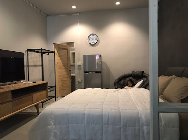 King size bed with refrigerator, cable and smart TV