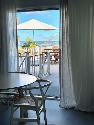 Barefoot, beach front comfort steps from the sand!