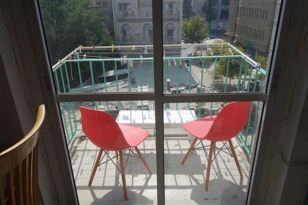 the balcony is perfect for a cold beer or  a fresh cup of coffee and is located right over the heart of Jerusalem's heart - Ben Yehuda street.