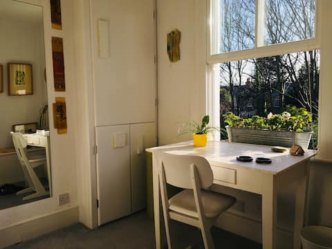 Lovely, sunlit room in an artist's house.
