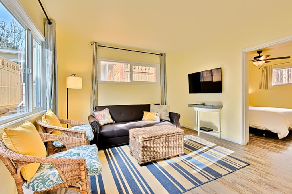 The Bright, Open Beach Inspired Living Room with Flat Screen TV