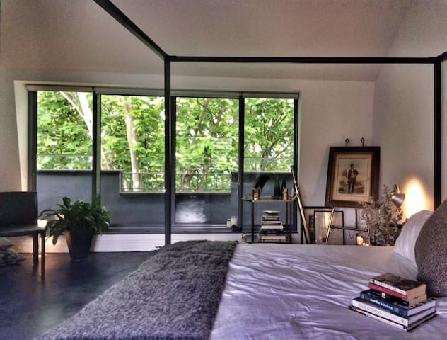 The master bedroom features a full-width balcony.