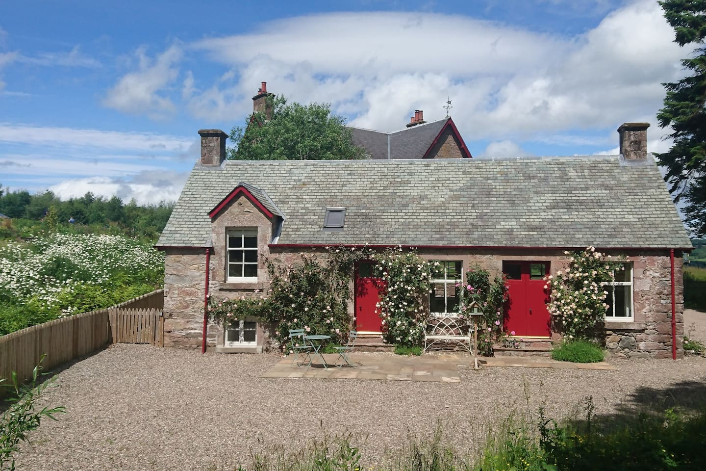 Rose Cottage - a sunny cottage smothered in scented roses