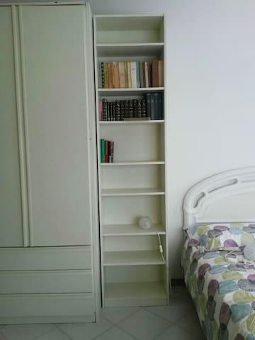 Wardrobe with bookcase.