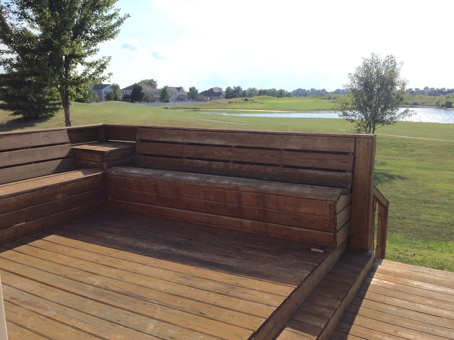 Beautiful back yard with a large deck facing Iron horse golf course.