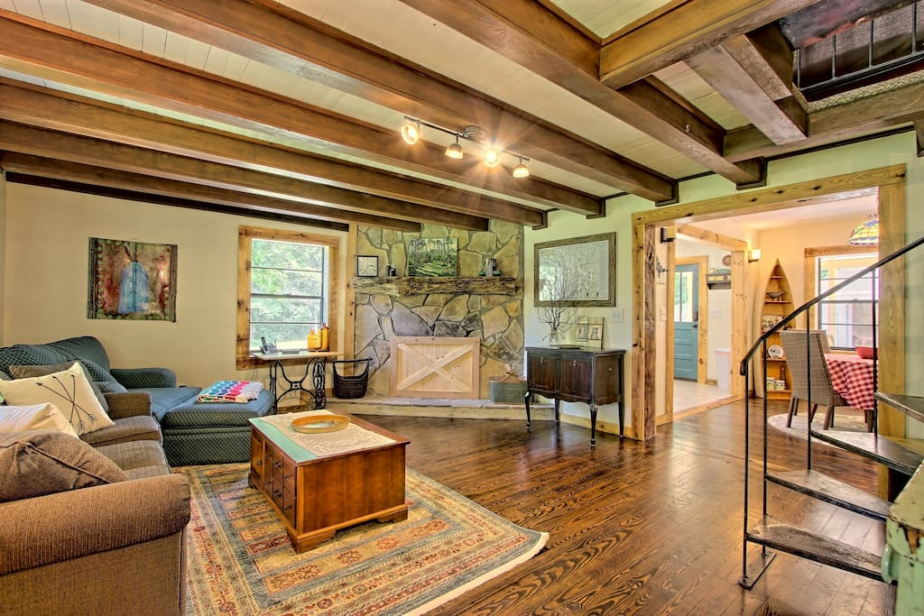 This 1,000-square-foot property offers a rustic and cozy feel with hardwood floors, wood beams, and a stone mantel.