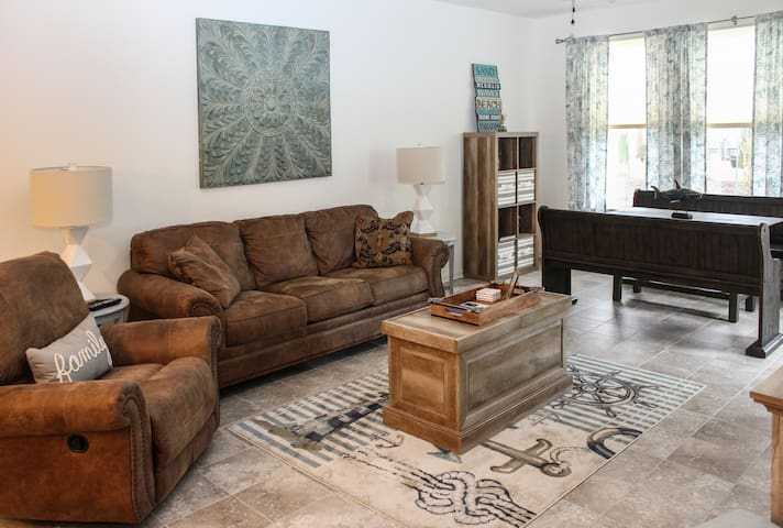 Relax in the open living area as you watch the large flat screen smart cable TV.