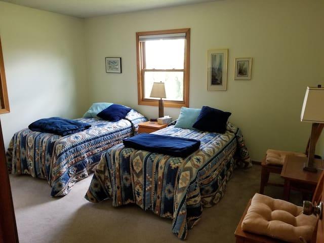 Bedroom in lovely cottage on Mississippi River