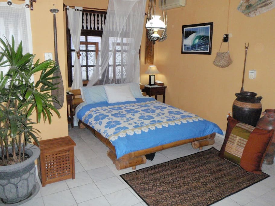 Large Upstairs Bedroom, A/C  Fan. T.V.  Private Balcony