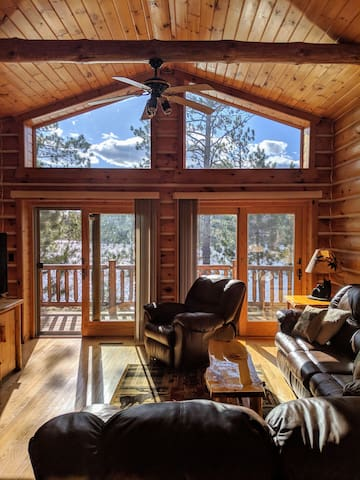 Exhale! Natural light floods into the open concept living room with a refreshingly scenic lake view. Sliding glass doors to enjoy the 360 wraparound deck. All seating reclines, so kick your feet up while entertaining or unwinding. Connected TV, too!
