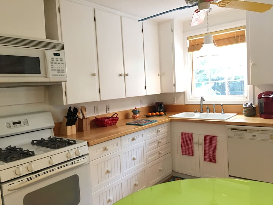 Gas stove in the kitchen with  a window to the tropical backyard.! The kitchen has a Keurig coffee maker, a blender/ smoothie maker and excellent pots and pans!