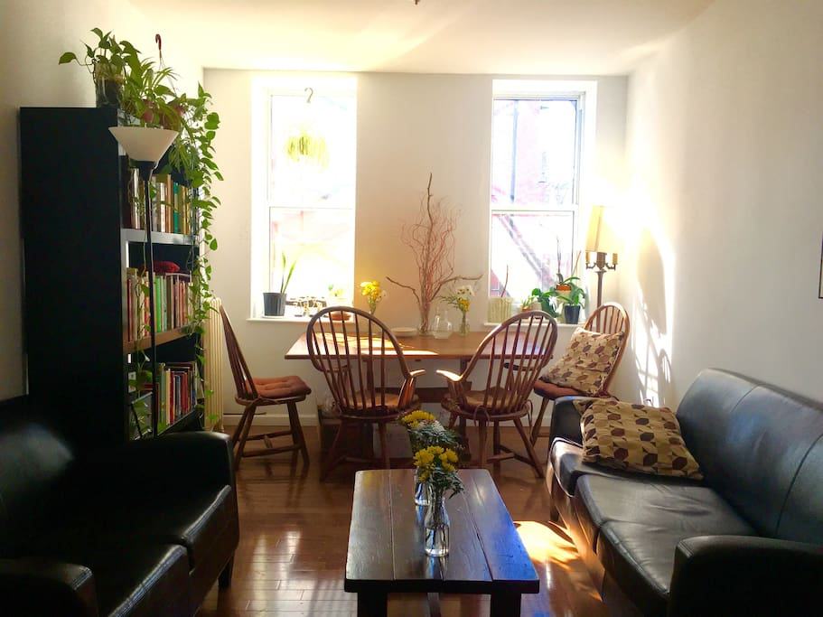 Spacious living room with large sun soaked table