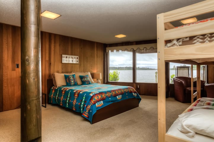 Lower level camp bedroom: queen bed and lake view