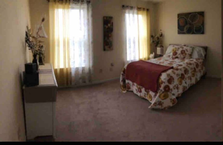 Bedroom 2 with full size bed and attached shared bathroom