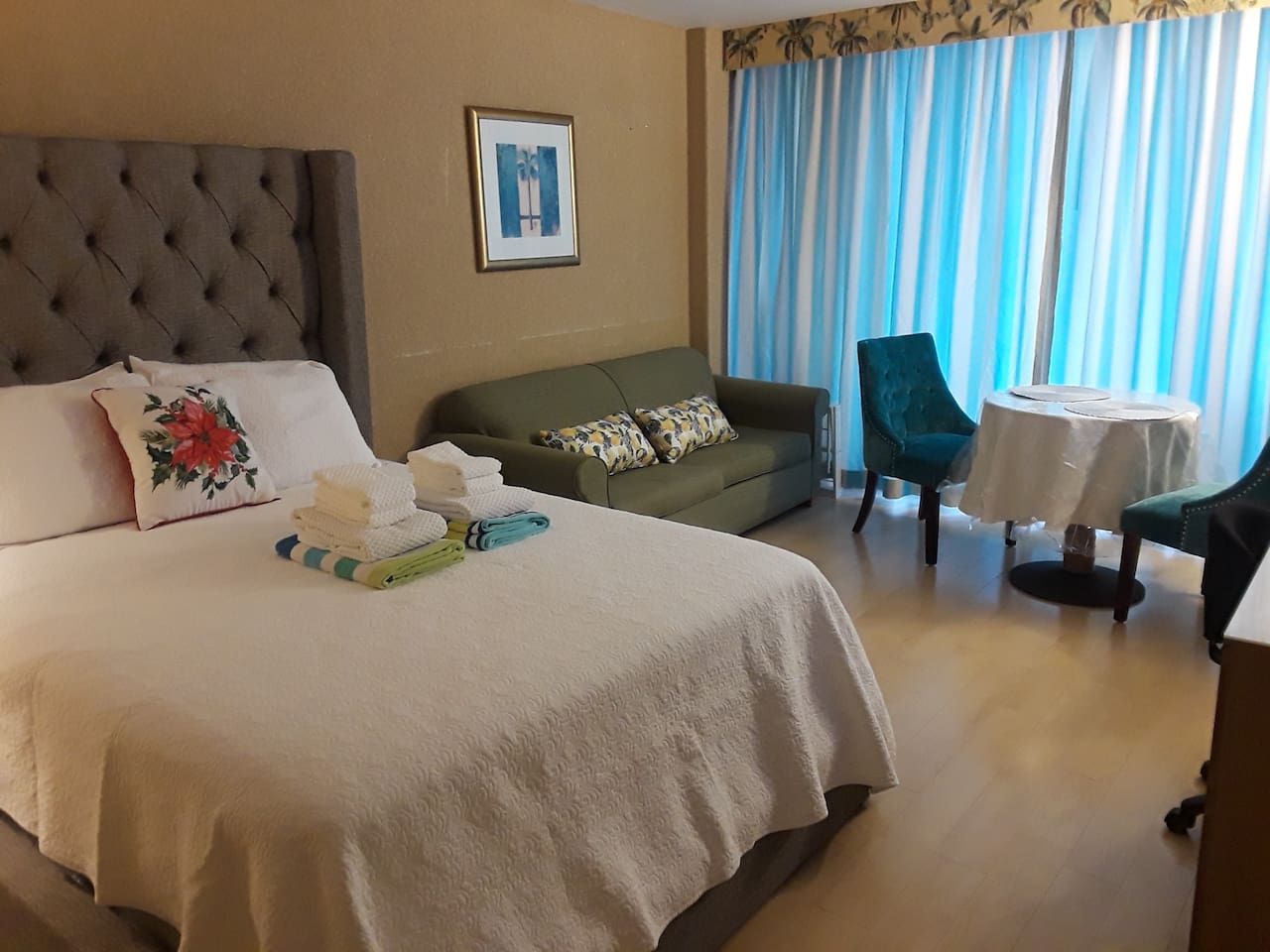 We have a queen size bed and long sofa and 2 chairs and dinner table. we have desk also.