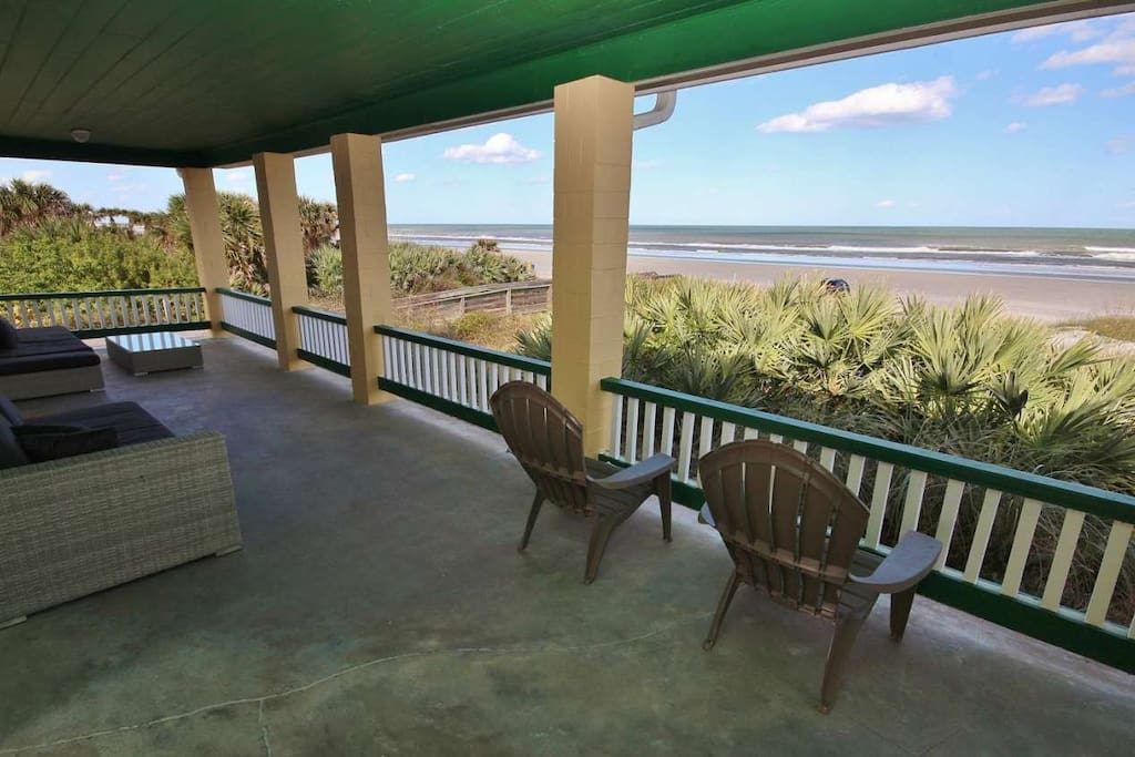 Watch the people at the beach from the comfort of your private veranda