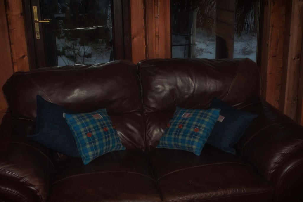 leather sofa with Harris Tweed cushions