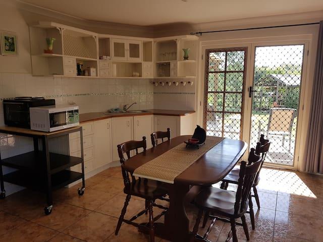 The kitchenette has a small oven with hot plates on top and a microwave with a bbq outside.