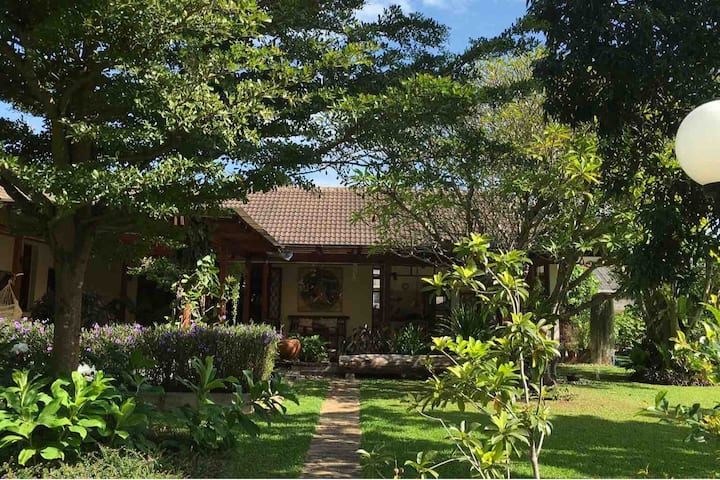 Peaceful suite in a garden with breakfast and maid