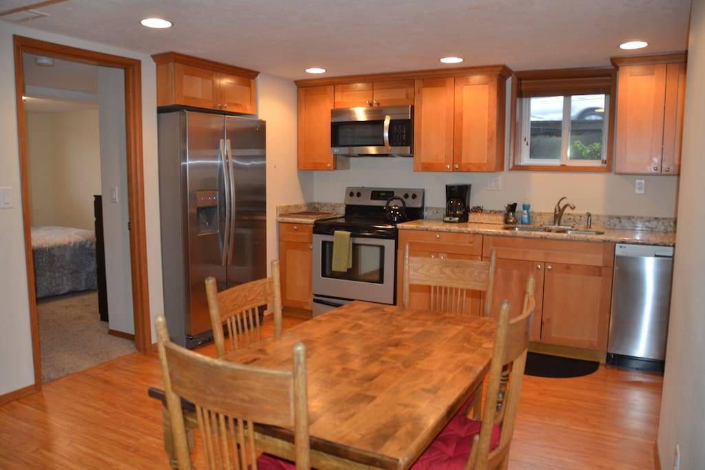 Full kitchen with granite and a stainless sink, a huge refrigerator, stovetop, oven,  microwave, dining table, it's pretty much all you need for a week!