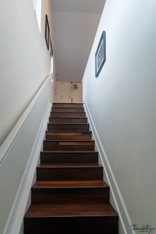 Studio apartment above our garage - stairs indoors up to the apartment