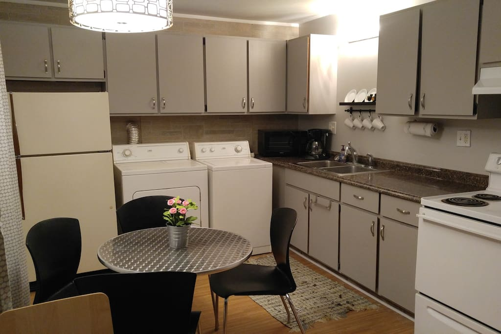 Updated kitchen with washer/dryer and microwave.